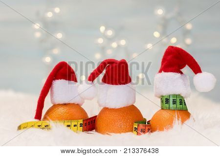Christmas background with tangerines and measuring meter. Concept of the Christmas diet