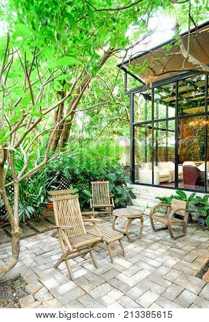 Wooden chairs and table in patio garden