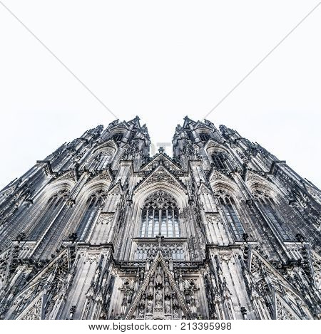 Europe culture concept - view of world cultural heritage cologne cathedral under dramatic sun and morning blue cloudy sky in Germany