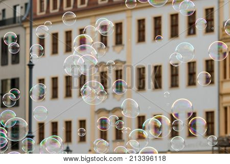 Soap Bubbles In Front Of An Old House