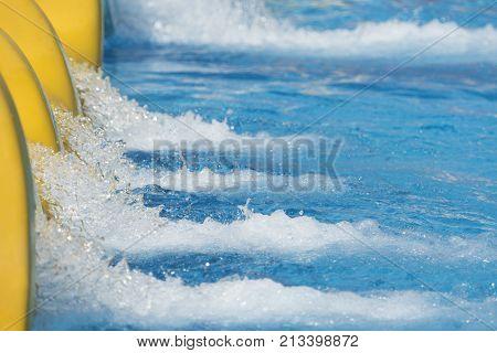 Splash Of Water From Slide In Swimming Pool