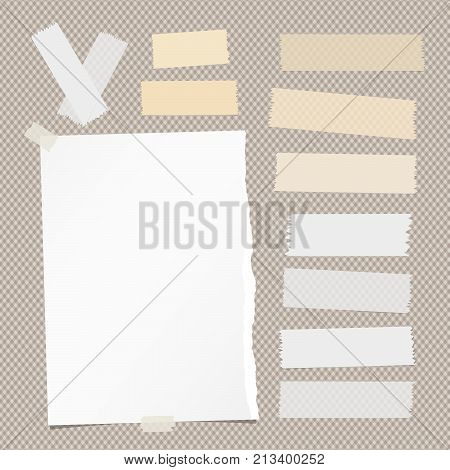 White ripped notebook, note paper sheet, sticky adhesive sticky tape for text or message on brown squared background
