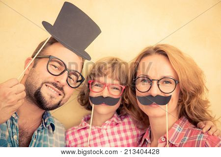 Portrait of funny family with fake paper mustache