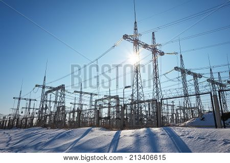 High voltage power lines in the winter. Thermal power plant. High-voltage transformer substation. poster