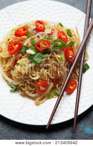 Asian instant noodles with bean sprouts, spring onion and chili pepper