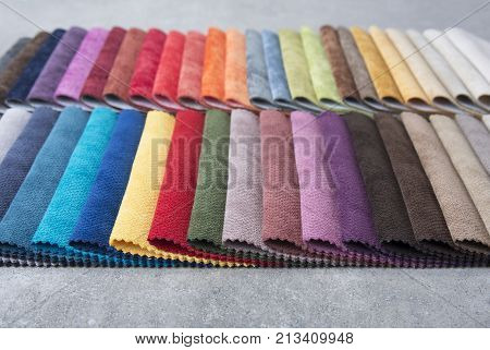 Colorful upholstery fabric samples in the store