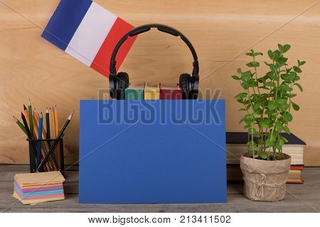 Concept Of Learning French Language - Blank Paper, Flag Of The France, Books, Headphones, Pencils On