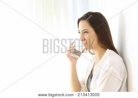 Woman Drinking Water Isolated At Side