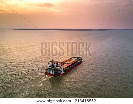 Medium container ship at estuary of Thailnad