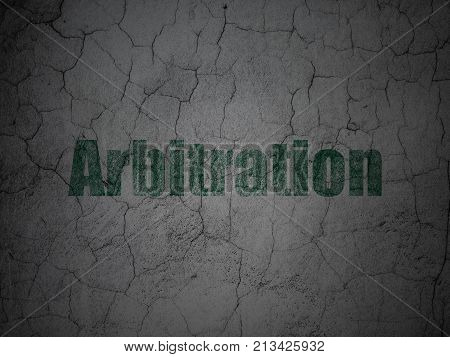Law concept: Green Arbitration on grunge textured concrete wall background