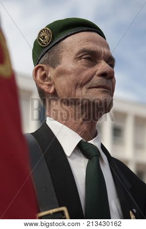 Aubagne, France. May 11, 2012. Portrait of a veteran of the French foreign legion in a green beret with the banner of veterans of the foreign legion during the annual meeting of veterans.