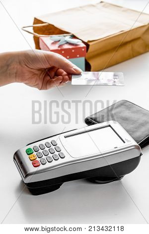 payment by credit card for gift in box in shop on white desk background