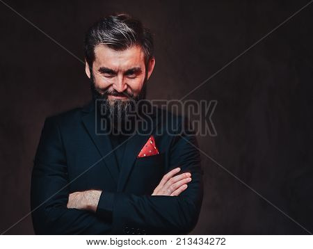 A stylish bearded playboy male dressed in an elegant suit.