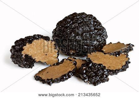 Black truffle mushrooms, whole and sliced, isolated on white background.