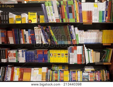 CATANIA, ITALY. April 3, 2015: Shelving with language books. A library with shelves and books to study languages inside