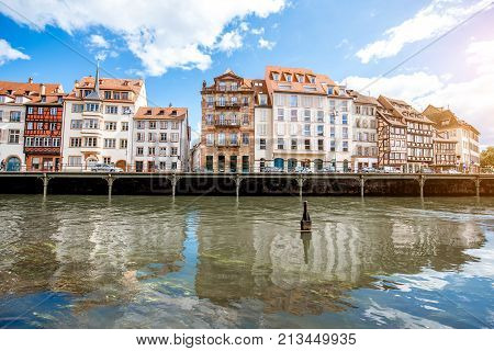 Landscape view on the water channel with beautiful half-timbered houses in Strasbourg city, France