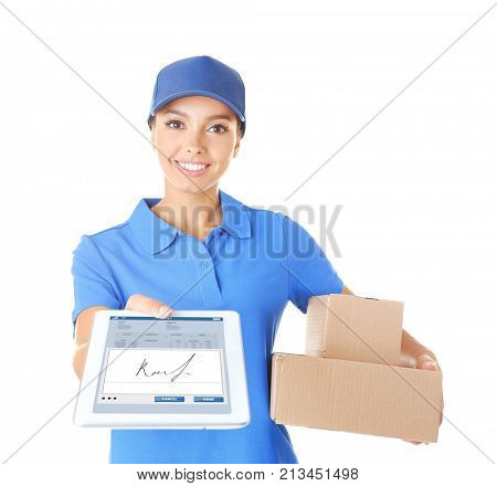 Delivery woman in uniform with tablet and parcels on white background. Signature capture app on screen