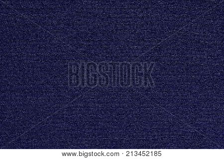 abstract macro texture of damp synthetic fabric for a background of dark violet color