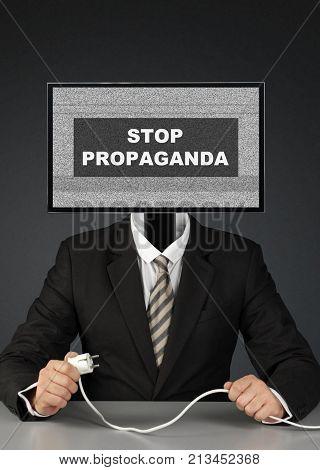 businessman with tv head stop mass media propaganda concept