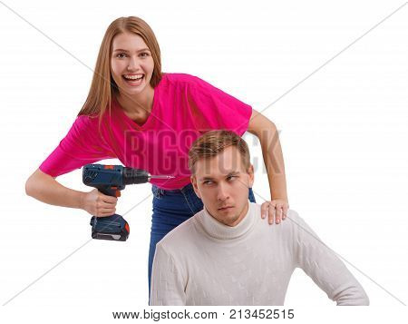 A beautiful, happy girl with a smile wants to drill a sullen guy's head sideways on a white isolated background