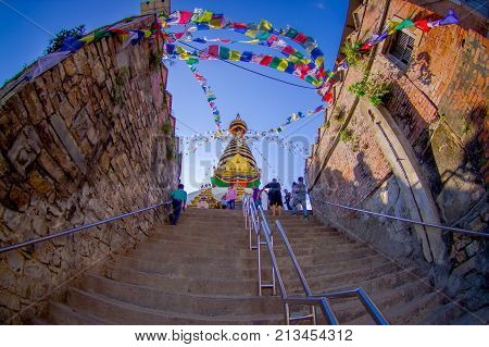 KATHMANDU, NEPAL OCTOBER 15, 2017: Stairs leading up to Swayambhu, an ancient religious architecture atop a hill west of Kathmandu city. It is also known as Monkey Temple.