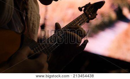 Woman playing music with balalaika. Lifestyle concept. Russian instrument. Folk music russian ensemble - woman playing the balalaika.