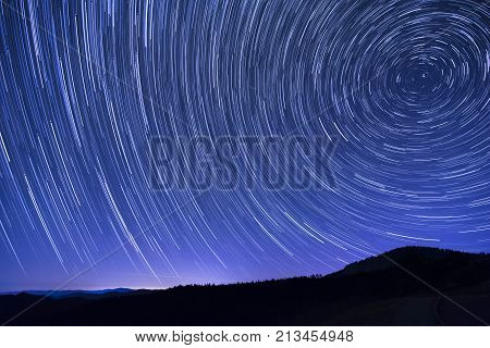 Star trails as seen from the Cowee Mountain Overlook on the Blue Ridge Parkway in western North Carolina.