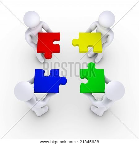 Four People Holding Puzzle Pieces