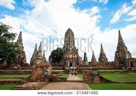 Ayutthaya Province Thailand - September 2 2017 : High prang in Khmer style with four smaller prangs construction stands on rectangular platform at Wat Chaiwatthanaram - vintage & history concept.
