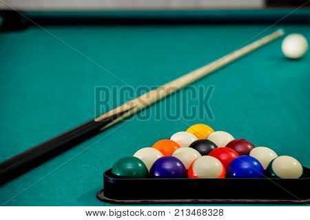 Sport, Recreation, Game, Competition - Playing Billiard. Billiards Balls An Cue On Billiards Table.