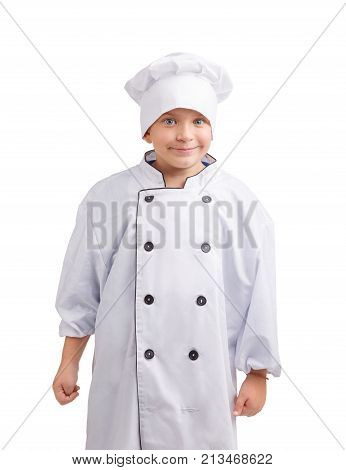 Little cook with a slight smile and a white cap on a white isolated background