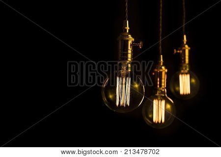 Illuminated filament light bulbs with copy space.