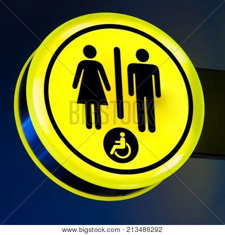 Toilets, wc icon for woman, men. Female, male public restroom signs with disabled access symbol. Interior of airport terminal.