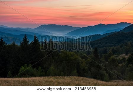 Gorgeous Red Dusk In Forested Mountain Landscape