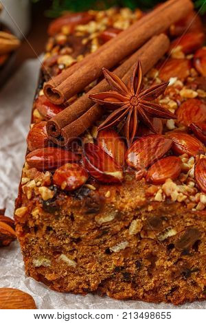 Homemade Holiday Fruitcake With Nuts, Fruits And Spices. Almonds, Cinnamon, Star Anise, Cardamom On
