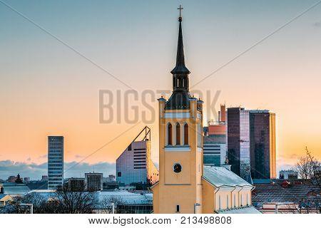 Tallinn, Estonia. Morning View Cityscape Of Church Of St. John Jaani Kirik Is Large Lutheran Parish Church In Tallinn Dedicated To St. John The Evangelist, Disciple Of Jesus Christ