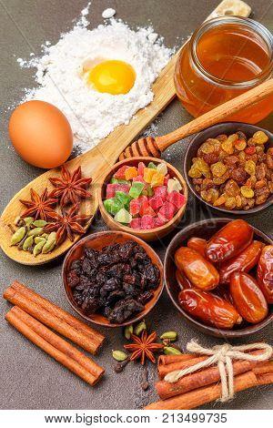 Baking A Fruitcake. The Ingredients On The Table - Dark And Light Raisins, Dates, Flour, Eggs, Honey