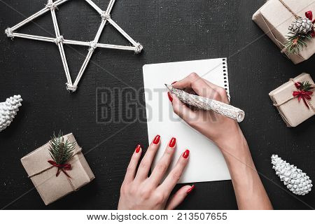 Christmas greeting card, now we will write the gift list that we expect from Santa Claus. Xmas ambience is supplemented by the plenty of surrounding gifts