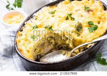 Gratin or Casserole from fish pasta broccoli and cheese in bechamel sause.