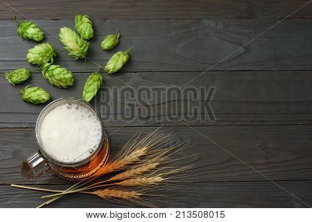 Glass Beer With Hop Cones And Wheat Ears On Dark Wooden Background. Beer Brewery Concept. Beer Backg