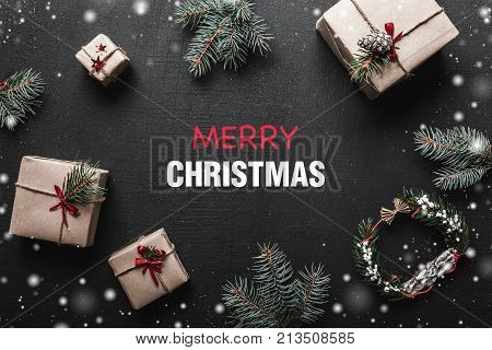 Christmas card. With congratulatory message space for loved ones. Gifts that wait for children between branches of fir. Xmas ambience is filled with gorgeous gifts
