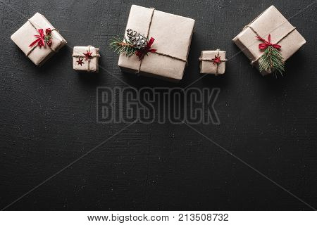 Christmas card. Symmetrically arranged gifts at the top of the image. Greeting card space. Xmas ambience is filled with gorgeous gifts