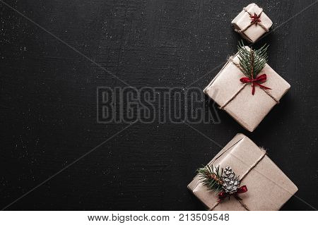 Christmas card. Symmetrically arranged gifts on the right side of the picture in the shape of decorative fir, holding space for Christmas message. Story Ambience.