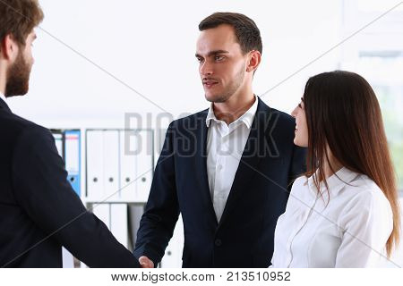 Escort service interpreter works with the transaction accompanies documents conclusion of the contract important situation. Arab businessman and his translator welcome business partner and says hello