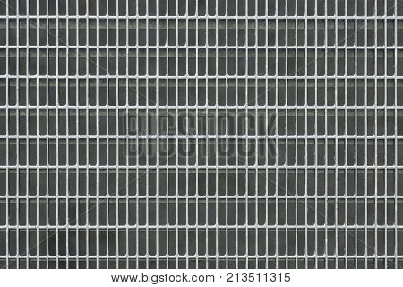 Close-up image of a metal grill. Metal grill texture.