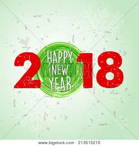happy new year 2018 over green old paper background with snowflakes holiday seasonal concept