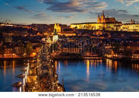 Night view of Prague castle and Charles Bridge over Vltava river in Prague, Czech Republic. Prague, Czech Republic