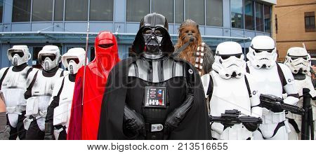 SHEFFIELD, UK - OCTOBER 7, 2017.  A group of cosplayers dressed as Darth Vader, Stormtroopers and Chewbacca from the  Star Wars movies at a comic con in the UK.
