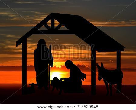 Christmas nativity scene, black silhouettes against a sunset background.