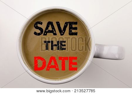 Save The Date Writing Text In Coffee In Cup. Business Concept For Special Day And Greeting On White